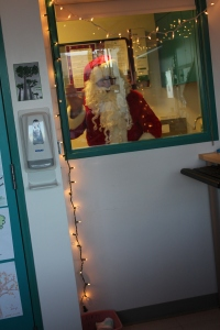 Our first Santa sighting through Caemon's window.