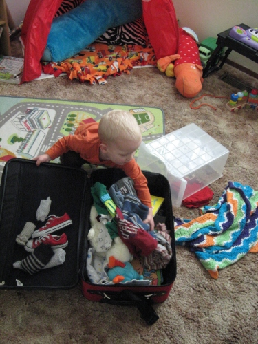 Caemon packing for a mini adventure.