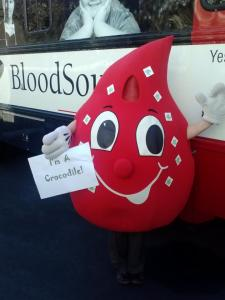 Drippy, the BloodSource mascot, covers himself in Crocodile tatoos.