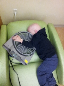 Caemon snuggling a fan he met in the hospital waiting room.